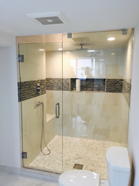 beautiful custom glass shower door and wall