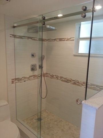 glass barn-door style shower enclosure