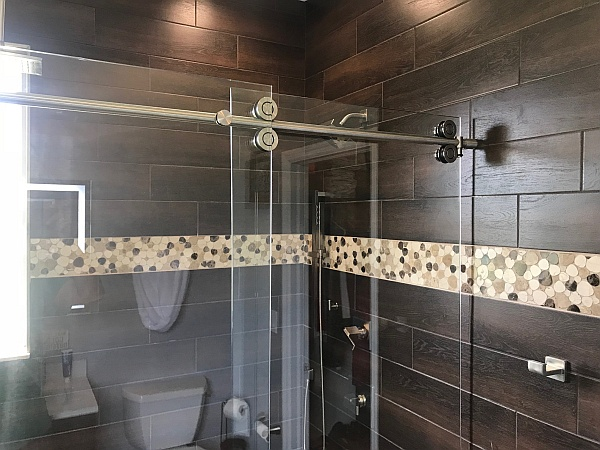 glass shower enclosure with glass sliding barn door