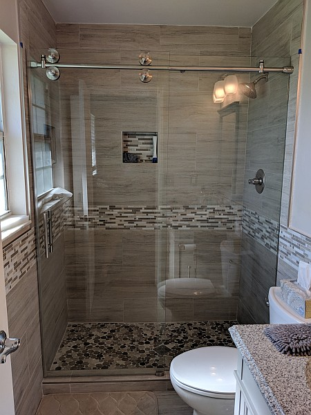 sliding glass shower door and wall