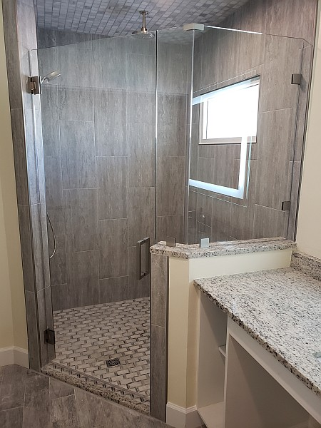 glass shower door and half wall