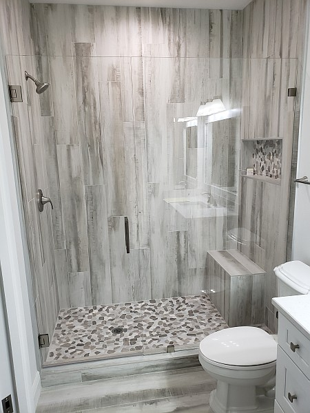 beautiful glass shower door and wall